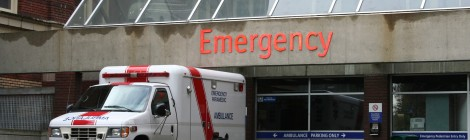 ambulance parked in front of emergency room