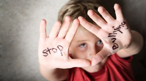 """boy with """"stop bullying"""" written on his hands"""